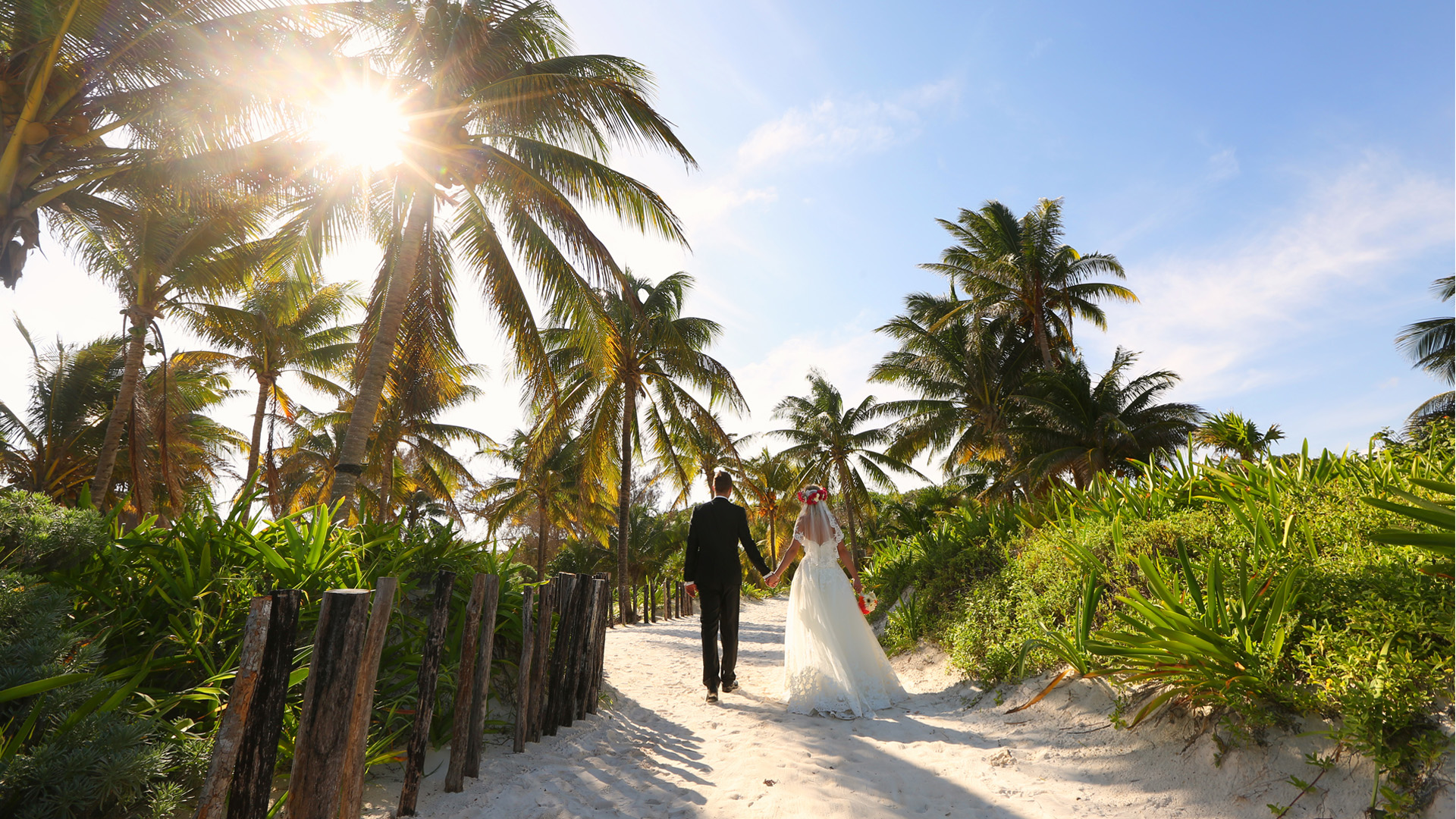 There are pros and cons to getting married abroad. It's not just about hopping on a flight and saying 'I do' on a beach, but it can be worth it. As well as the time of year, monsoon season, local customs and food, there are lots of things to consider when getting married abroad. Planning is key and you may have to book the wedding around 18 months before the event to ensure everything gets planned and people know about it beforehand. You have to think about accessibility for family and friends. Direct flights that are regular and affordable with a short travel time from the airport will give them more incentive to accept the invitation. You would also need to check the details of your marriage ceremony under local law. Each country has different rules when it comes to marriage. In many places, it can be difficult to have a legal ceremony unless you are resident for a number of weeks or months. In this case, the norm would be to have a legal ceremony at home and a symbolic blessing on the day. A local wedding planner who knows the area will be invaluable. From sourcing key suppliers, liaising with vendors in the region and explaining your requirements in the local language, the help will be essential. Choose an established, English-speaking planner who has experience working on weddings in your region and of the style you want to create. This does not mean that you shouldn't visit the venue, florist and bakery yourself. You need to ensure that it's what you want for your big day. Popular Abroad Weddings Europe Lake Garda, Italy Italy's largest lake stretches across three regions in the north of the country, so no wedding abroad in Lake Garda will ever be the same as each other. At its northern end, the mountainous scenery makes a stunning backdrop for your photos with historic castles as the perfect venue. In the south of Lake Garden, the lakeside has an almost Mediterranean feel and relaxed waterfront towns where you can tie the knot. Santorini, Greece Magical sunsets, breathtaking views, towering cliffs and whitewashed villages. This crescent-shaped islands in the Aegean Sea is Santorini, the little paradise on earth which will complete your vows of a lifetime of love and togetherness. Plan your dream wedding on a panoramic terrace on the edge of the Caldera, in one of the famous Santorini wineries or on one of the renowned black volcanic sand beaches. As the sun is setting, the glow of the orange and red in the cliffs will be cherished forever. Caribbean White-sand beaches, Bombay Sapphire waters and an infectious party spirit means that the islands of the Caribbean were made for weddings. Each island has something different to bring the the table. Aruba is home to some of the longest, whitest beaches going, the Dominican Republic livens up evening do's with merengue music and rum cocktails, and Jamaica offers a reggae soundtrack and a laid-back attitude. Cuba does weddings with a Latino-style swing of the hips, combining all the traits of a Caribbean paradise with its iconic capital city, Havana. Then there is of course, St Lucia, where the two of you can stand at the altar with the mighty twin peaks of the Piton Mountains towering behind you. Latin America Whether you fancy golden sands and golden sunsets, or beaches whiter than your wedding cake, Latin America delivers. Opt for Mexico and you'll have a choice between the east and west coasts. In the east, it's all white sands, Tiffany-blue waters and A-list-worthy hotels. While on the west coast you can expect sunset ceremonies overlooking caramel-coloured sands, with the Sierra Madre mountains as a backdrop. Further south, Costa Rica has the same gold sands and sunset vistas, but with the added dose of adventure.